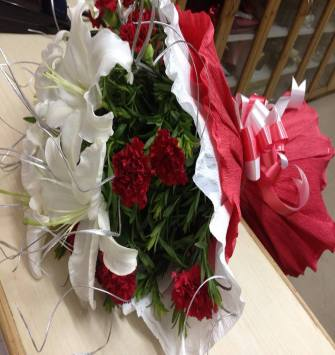 lilies and red carnation bunch
