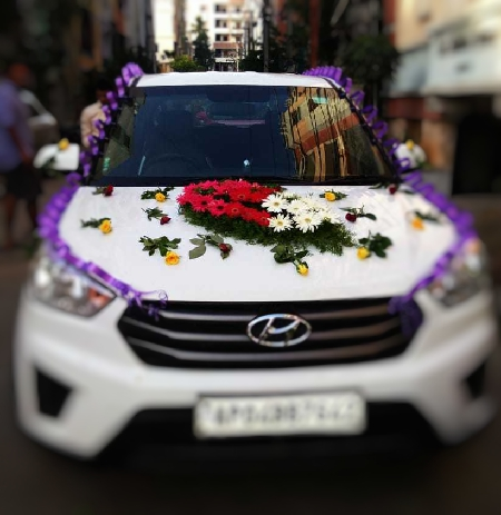 Car Deco with 2 Arrangements and 50 Mix Roses