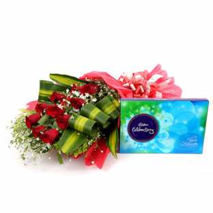 12 Red Roses in Red Paper Packing with Cadbury Celebration Box
